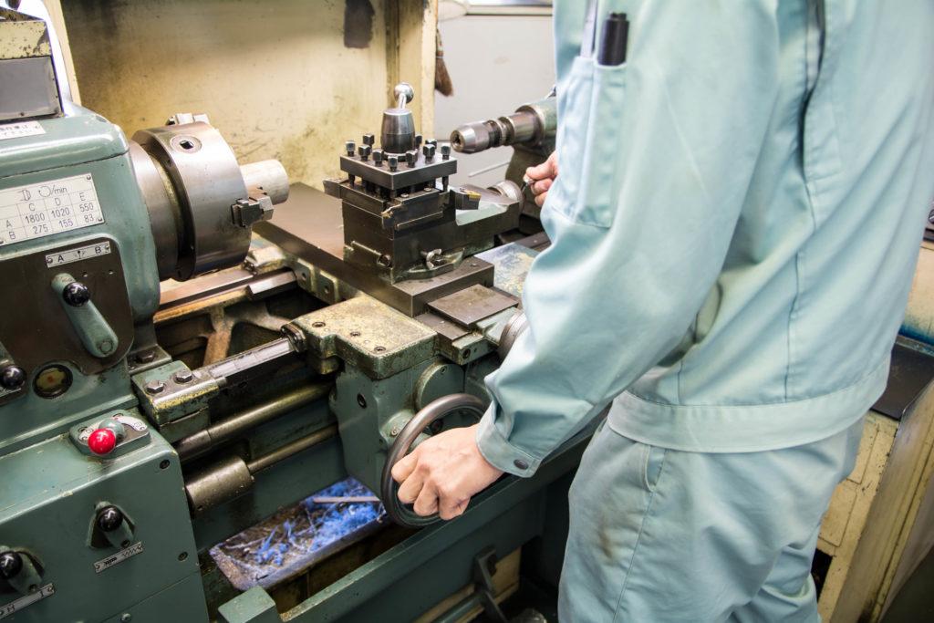 a mechanic working on a machine