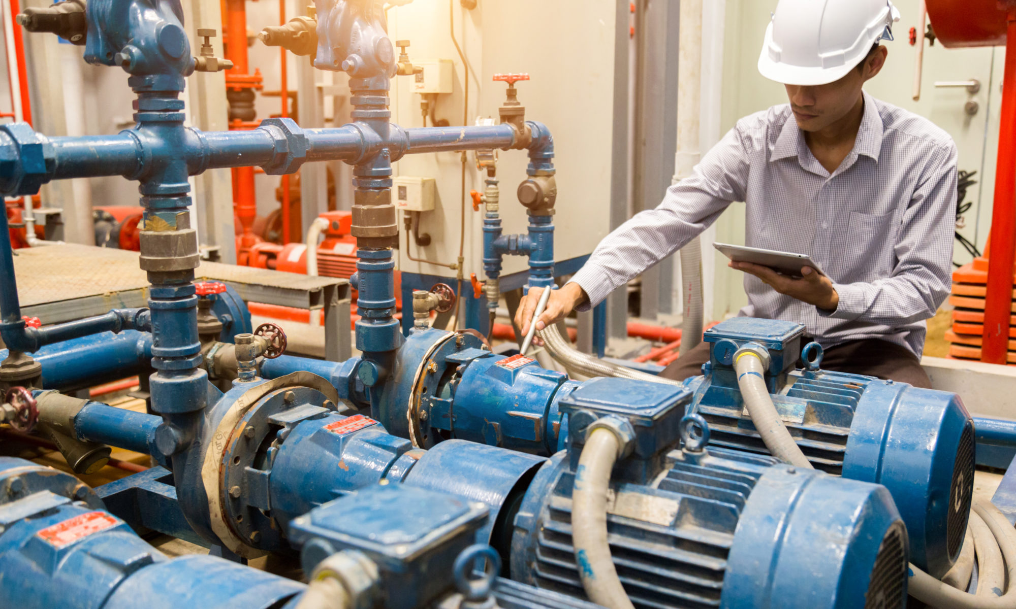 engineer maintenance checking technical data of system equipment Condenser Water pump and pressure gauge , water pump.